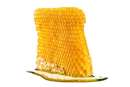 Honeycomb with honey isolated on white background