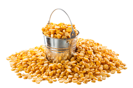 Dried peas in a bucket on a white background Stock Photo