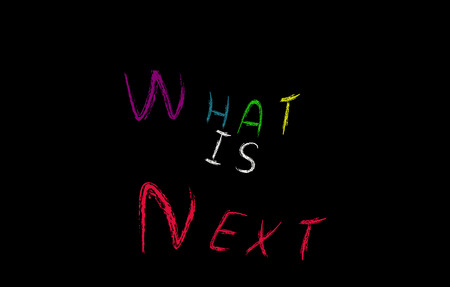 What is next concept, colorful words on blackboard photo