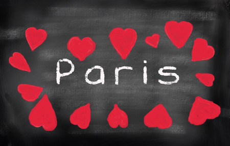 Paris written on a used blackboard and surrounded by chalk drawings of heart shapes photo