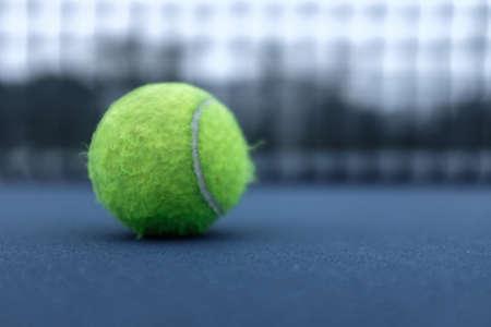 Close up shot of a tennis ball on a Richmond, VA court.