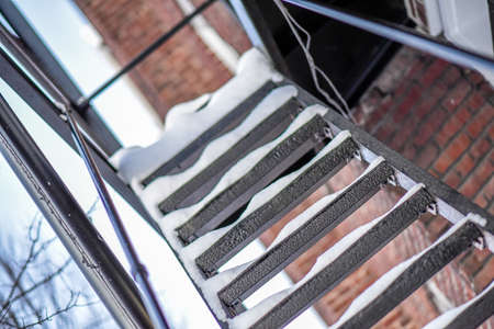 Snow covered apartment stairs in the city. Reklamní fotografie - 95277041