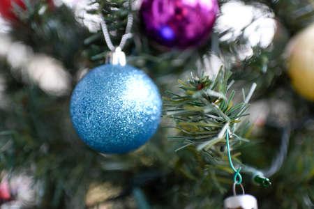 Christmas ornaments hanging from christmas tree. Reklamní fotografie