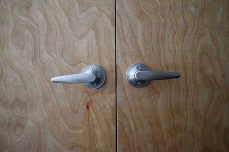 Close up shot of two door handles.