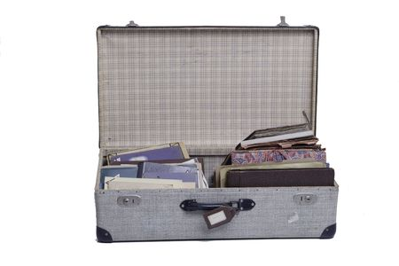 old suitcase with journal and old books