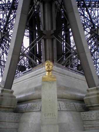 parisian scene: Statue of Gustave Eiffel near Tower, Paris, France Editorial