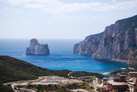 mineralization: Shot of the islet of limestone Pan di Zucchero, on the coast of Nebida-Masua in south-western Sardinia