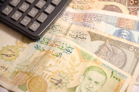 coppers: Calculator on Syrian pound background