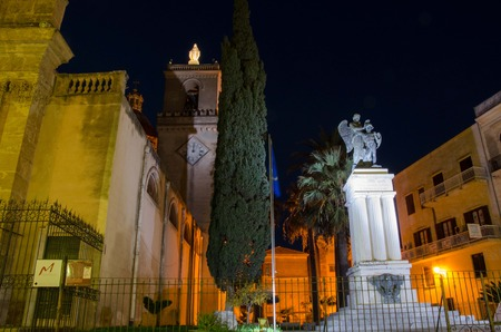 Basilica Santa Maria Assunta and the Great War Memorial in Alcamo, Sicily. Editorial