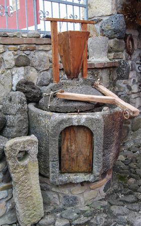 millstone: Ancient grain grinding millstones hand Stock Photo