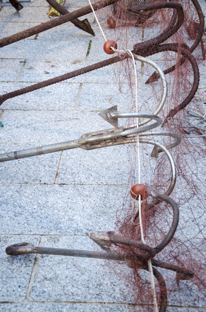 fishery: Fishery tool and anchor Stock Photo