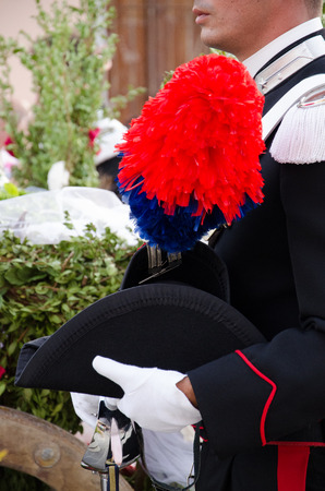 hat with feather: Carabinieri, Italian policemen with feather plumed hat bicornuate Stock Photo