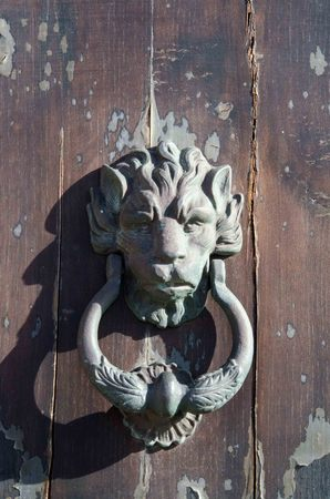 doorknob: Old iron handle in the shape of lion Stock Photo