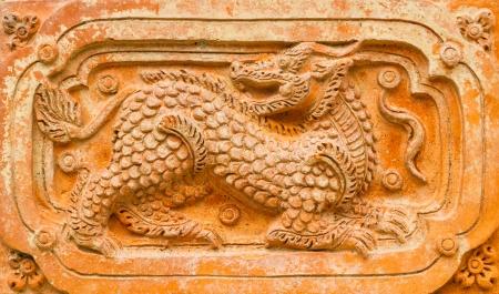 dragon in brick  photo
