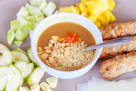 seekh: vietnamese cuisine , roasted pork served with spicy (Nam Neung)  Stock Photo