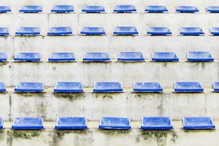 grandstand: arena tribuna antiguo con silla azul