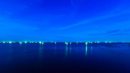 light of boat fishing on center sea  photo