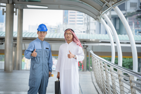 arab business and engineering standing show symbol like on hand Stock Photo
