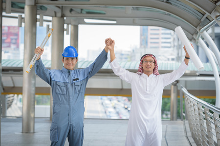 headcloth: arab business and engineering read blueprint building structures and show hand when job success