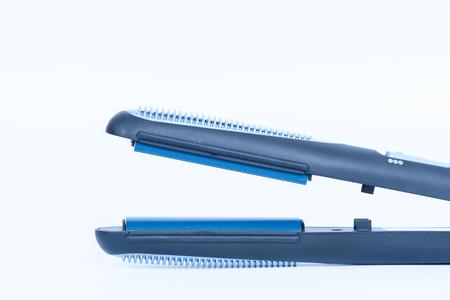 Modern hair straightener on white background