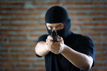 criminal hand holding shot gun  inside building structure, stealth concept