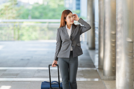 headcloth: business woman hand holding a suitcase walking to airport