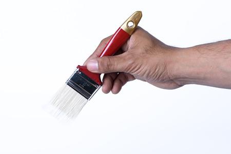 hand on red paintbrush isolated on white background