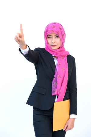 beautiful modern muslim business woman portrait pointing  on white background Stock Photo