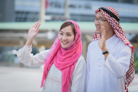 headcloth: arabian couple greetings when first time to talking about business