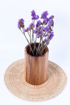 wood vase classic with a bouquet of purple flowers on white background Stock Photo