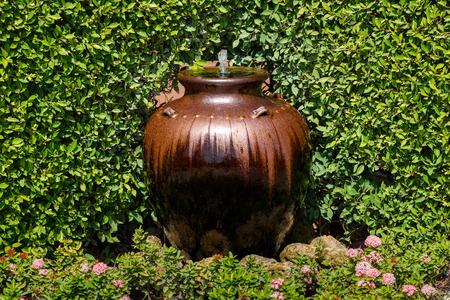 jar decorative fountain in the garden Stock Photo