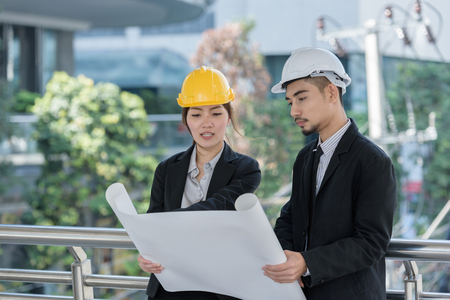 architecture worker man and woman discussion about building blueprint