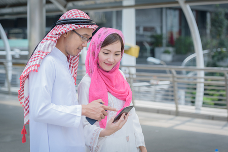 arabian couple hand holding bags colorful  when shopping day