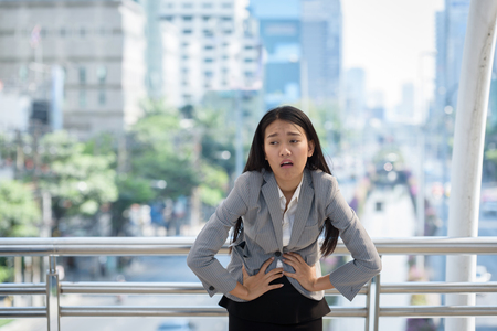 businesswoman stomach ache when work hard dont eating anything on work day