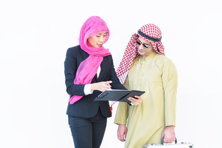 headcloth: beautiful modern muslim business woman and young man work with report today on white background