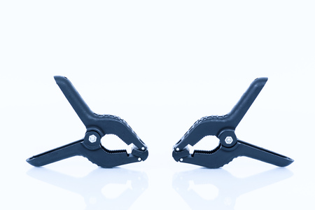 plastic clamp black pliers on white background Stock Photo