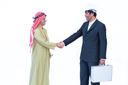 arab businessman and foreman check hand when business success