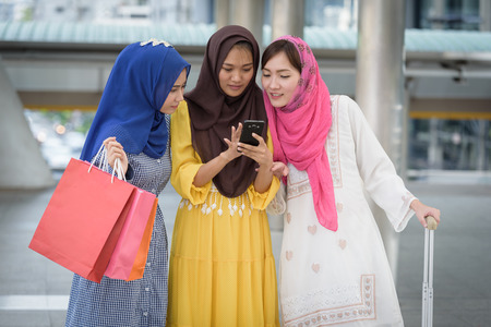 arabia business woman or girl with shopping bags colorful online when payday in city structure