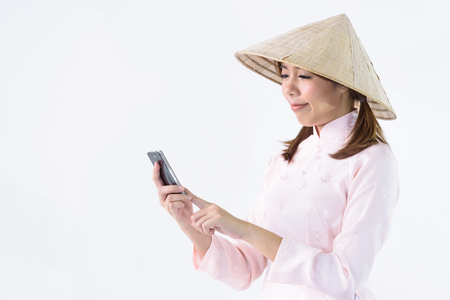 Beautiful woman vietnam culture traditional dress hand on mobile phone,traditional costume