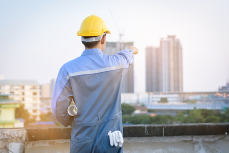 construction engineer standing on top roof check quality building