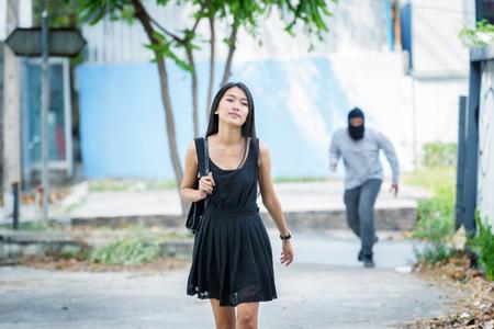 criminal hand holding shot gun woman on street,rop concept