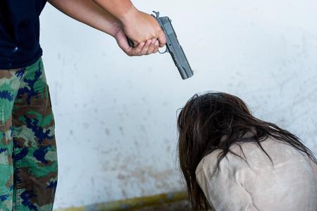 criminal hand holding shot gun woman inside building, stealth concept Stock Photo
