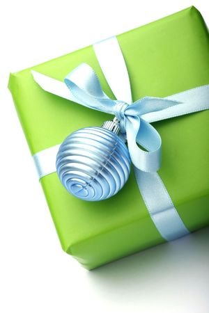 green present box with blue ribbon isolated on white background photo