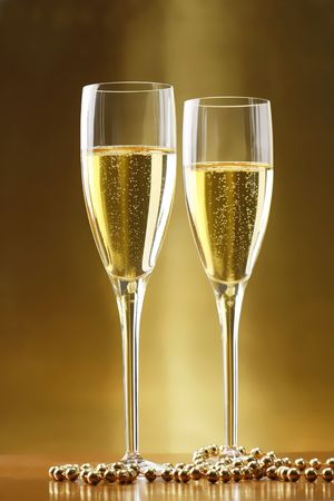 Glasses of champagne with gold background photo