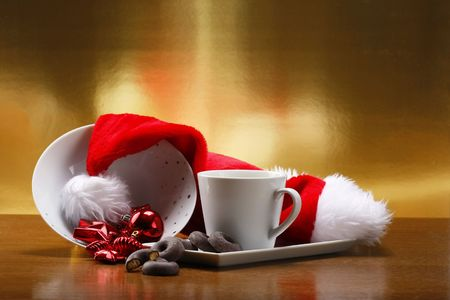 milk and cookies for santa on table with gold background photo