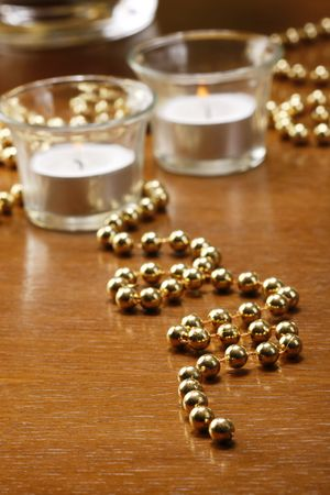 dryed: Glasses of champagne with gold background with walnuts, candels and dryed raisins
