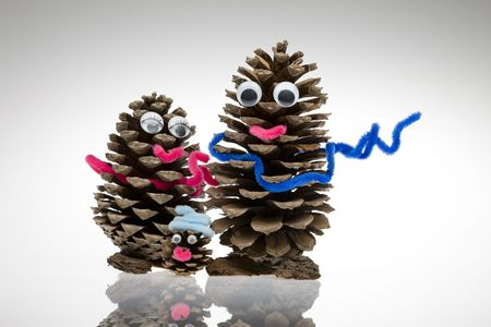 Isolated pine cone with scarf, eyes and mouth Stock Photo - 8180207