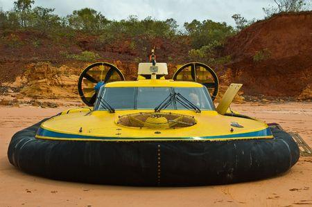 aquatic reptile: A hovercraft parked on an isolated beach in the North of Western Australia.