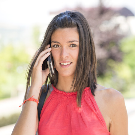 woman on phone: Attractive woman talking on phone. Stock Photo