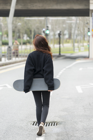 adolescence: Hipster young woman walks on road in the street, adolescence lifes